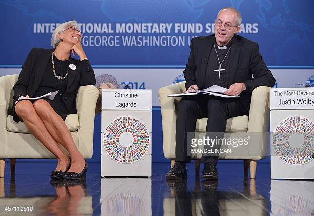 Archbishop of Canterbury Justin Welby speaks watched by International Monetary Fund Managing Director Christine Lagarde during a discussion on ethics...