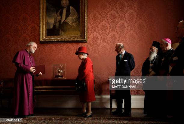 Archbishop of Canterbury Rowan Williams shows Britain's Queen Elizabeth II and Prince Philip, Duke of Edinburgh , the Ampulla and Coronation Spoon...