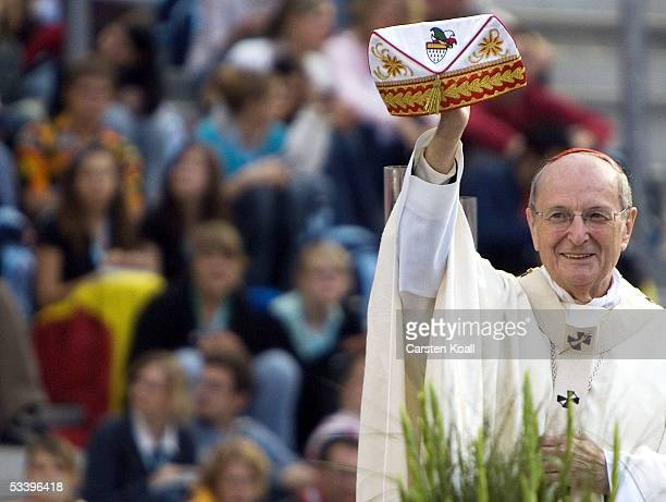 Archbishop of Cologne Cardinal Joachim Meisner shows a typical colonial foolscap on the World Youth Day opening mass at the RheinEnergie Stadium...