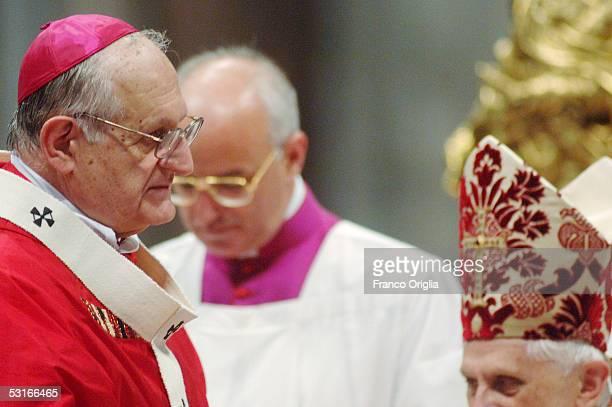 Archbishop of Galveston-Houston Joseph Anthony Fiorenza looks Pope Benedict XVI who bestowed on him the pallium, a woolen shawl, during the Solemnity...