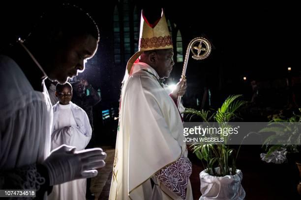 TOPSHOT Archbishop of Kinshasa Fridolin Ambongo Besungu is pictured at the start of Christmas Mass celebrations at the Notre Dame de Kinshasa...