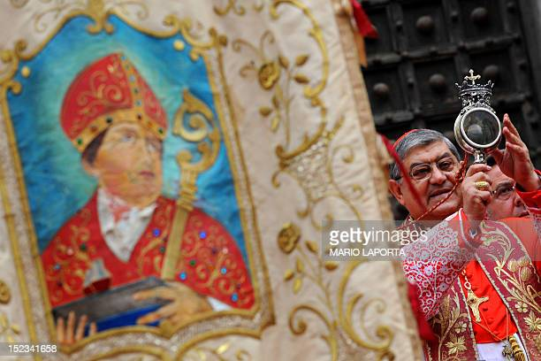 Archbishop of Naples Cardinal Crescenzio Sepe shows an ampoule containing blood of Saint Januarius outside Naples cathedral on September 19 2012...