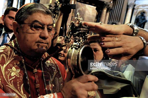 Archbishop of Naples Cardinal Crescenzio Sepe shows an ampoule containing blood of Saint Januarius inside Naples cathedral on September 19 2012 Saint...