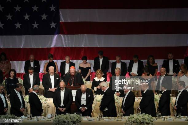 Archbishop of New York Cardinal Timothy Dolan leads a prayer before dinner at the annual Alfred E Smith Memorial Foundation dinner October 18 2018 in...