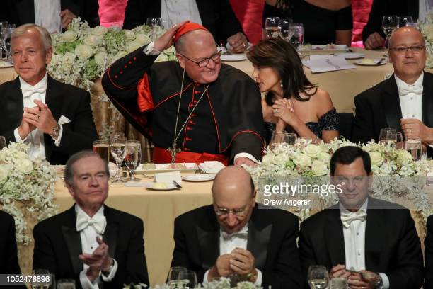 Archbishop of New York Cardinal Timothy Dolan talks with US Ambassador to the United Nations Nikki Haley during the annual Alfred E Smith Memorial...