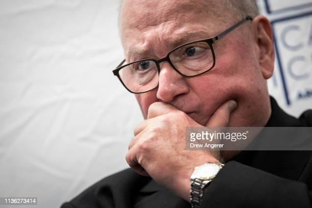 Archbishop of New York Timothy Dolan looks on during a press briefing about immigration and border issues at the offices of Catholic Charities...