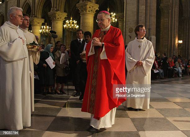 Archbishop of Paris Cardinal Andre VingtTrois leads a procession during a mass for Cardinal JeanMarie Lustiger at the NotreDame Cathedral on August 9...