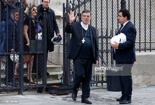 Archbishop of Paris Mgr Michel Aupetit waves as he leaves after celebrating the first mass at Notre Dame de Paris since fire destroyed the roof of...