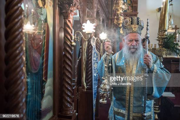 Archbishop of Thyteiri and Great Britain blesses parishioners and clergy during a traditional Greek Orthodox blessing at the Church of St Michael the...