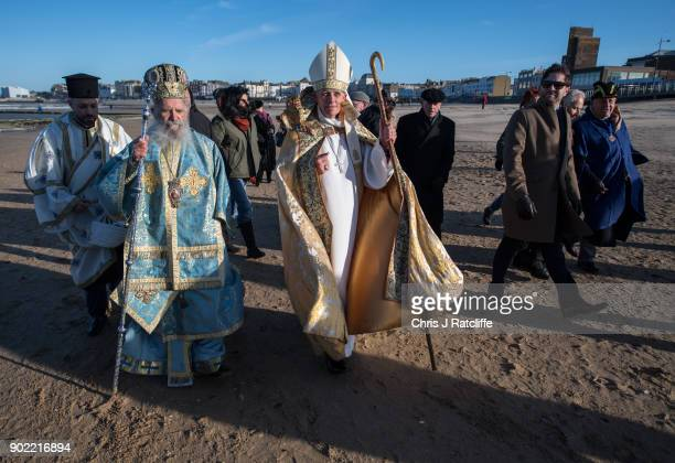 Archbishop of Thyteiri and Great Britain of the Greek Othodox Church and Bishop of Dover process along Margate beach with parishioners and clergy...