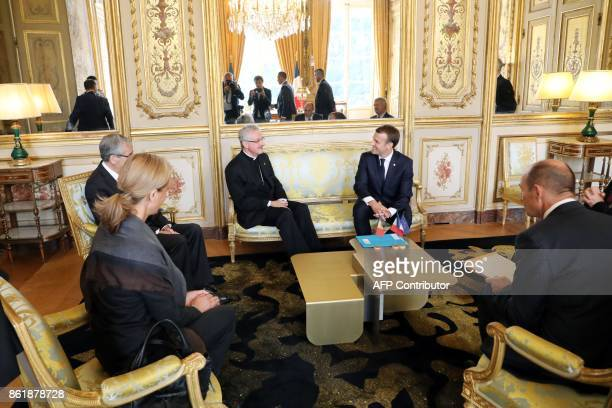 Archbishop of Urgell and CoPrince of Andorra JoanEnric Vives Sicilia I speaks with French President Emmanuel Macron during a meeting at the Elysee...