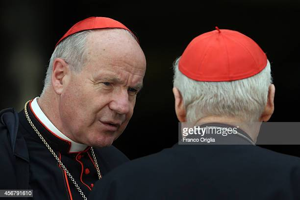 Archbishop of Vienna cardinal Christoph Schonborn chats with Archbishop of Milan cardinal Angelo Scola as they leave the Synod Hall at the end of a...