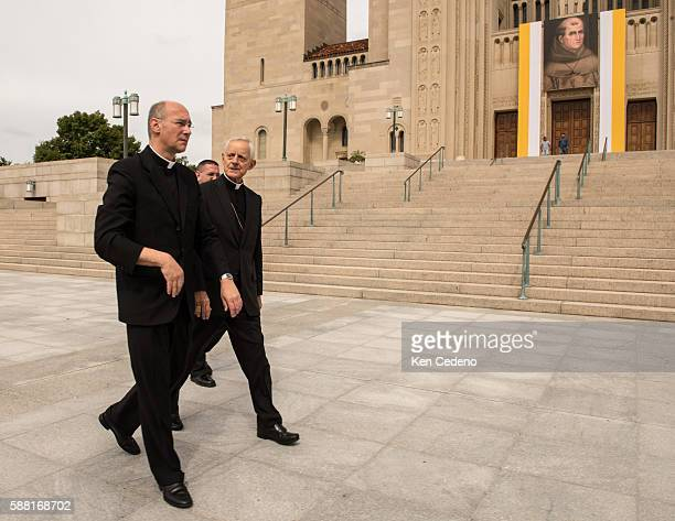 Archbishop of Washington Cardinal Donald W Wuerl right walks with staff viewing the front of the Basilica of the National Shrine of the Immaculate...