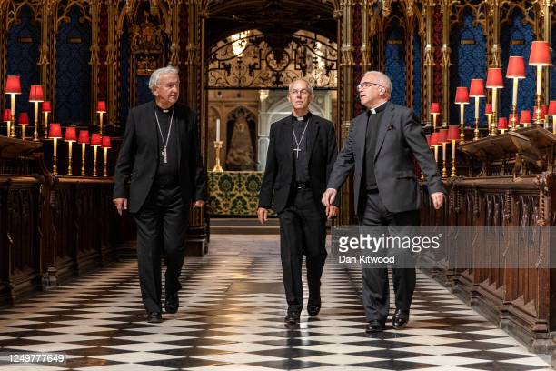 Archbishop of Westminster, Vincent Nichols, Archbishop of Canterbury Justin Welby and Dean of Westminster David Hoyle walk to the shrine of Edward...