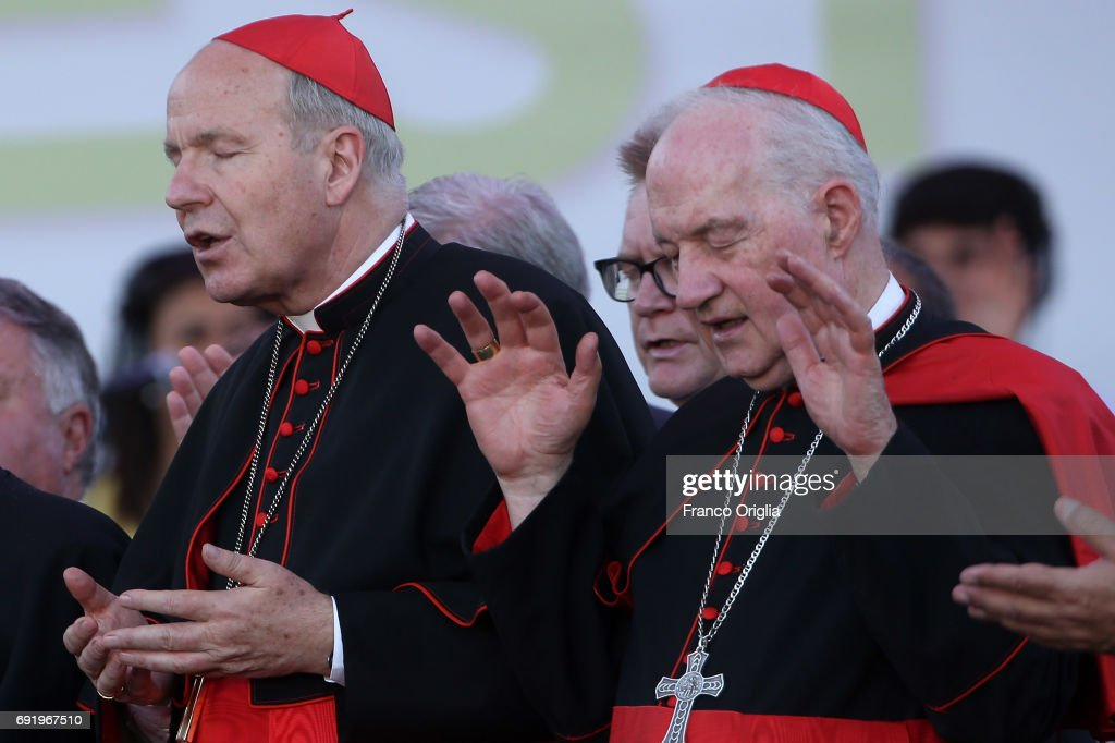 Archbishop of Wien cardinal Christoph Schonborn (L), and Canadian cardinal Marc Ouellet (R) attend The Golden Jubilee of the Catholic Charismatic Reneval at the Circo Massimo on June 3, 2017 in Rome, Italy. Pentecostal and Charismatic Christianity numbers over 500 million adherents.
