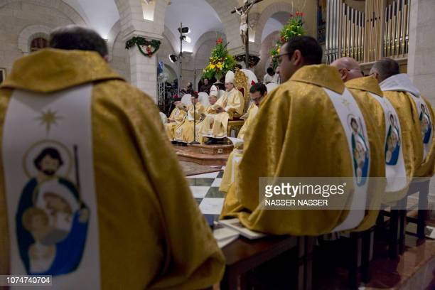 Archbishop Pierbattista Pizzaballa the top Roman Catholic cleric in the Holy Land heads a Christmas midnight mass at Saint Catherine's Church in the...