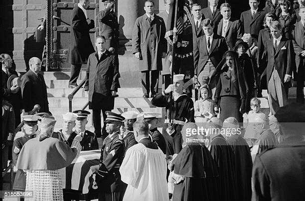 Archbishop Richard Cushing blesses the coffin containing the remains of President John F Kennedy outside St Matthew's Cathedral