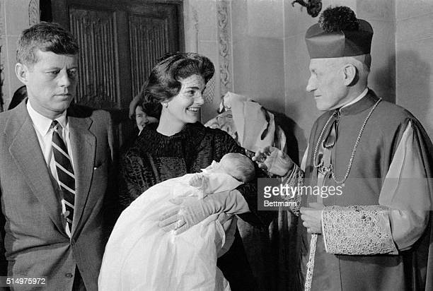 Archbishop Richard Cushing of Boston blesses Caroline Bouvier Kennedy first child of Senator John Kennedy after the child was baptized at St...