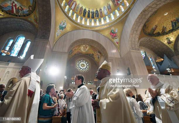 Archbishop Wilton Gregory right center joins a procession during his installation as the seventh Archbishop of Washington at the Basilica of the...