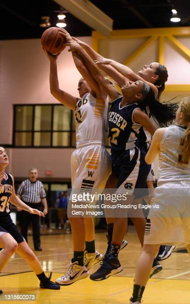 Archbishop Wood's Aubrey Brown pulls in a rebound in front of Conrad Weiser's TaCari Talford and Conrad Weiser's Hannah Racis .GIRLS BASKETBALL...