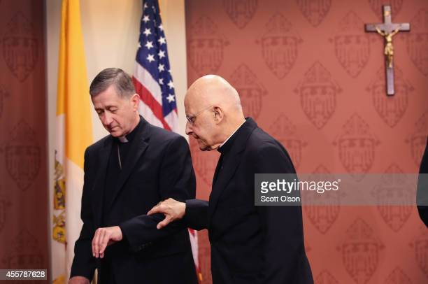 ArchbishopElect Blase Cupich helps Francis Cardinal George from the lecturn during a press conference on September 20 2014 in Chicago Illinois Cupich...