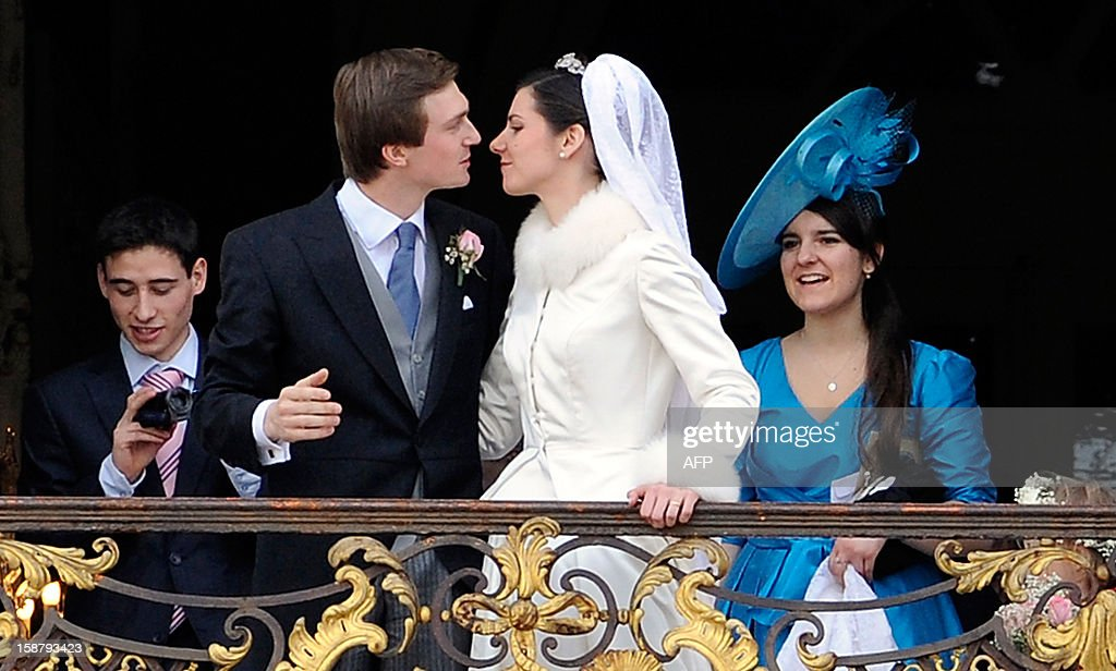 Archduchess Adelaide Drape-Frisch (3rd R) and archduke Christoph of Austria (2nd L) kiss on the balcony of the Nancy tonwnhall, on December 29, 2012, in Nancy.