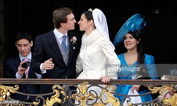 Archduchess Adelaide DrapeFrisch and archduke Christoph of Austria kiss on the balcony of the Nancy tonwnhall on December 29 in Nancy AFP PHOTO /...