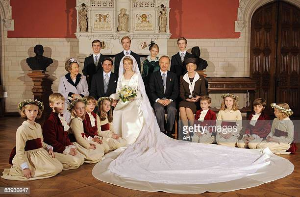 Archduchess Marie Christine of Austria and Count Rodolphe of Limburg Stirum pose for a family picture after their civil wedding at the City Hall of...