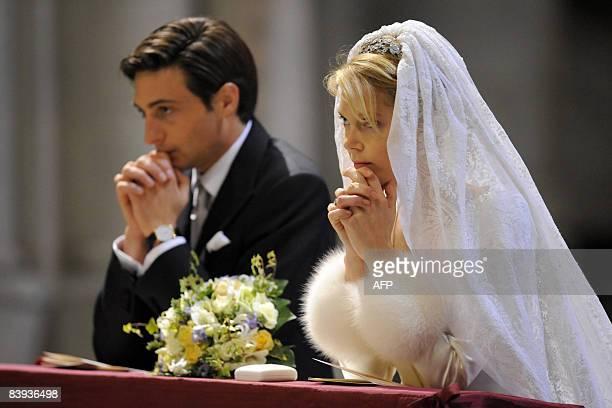 Archduchess MarieChristine of Austria and Count Rodolphe of Limburg Stirum kneel in pray in 'SintRomboutskathedraal' during their wedding ceremony in...