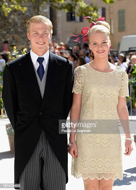 Archduke Alexander and Archduchess Gabriella depart the Religious Wedding Of Prince Felix Of Luxembourg and Claire Lademacher at the Basilique Sainte...