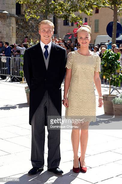 Archduke Alexander and Archduchess Gabriella depart the Religious Wedding Of Prince Felix Of Luxembourg and Claire Lademacher at Basilique Sainte...