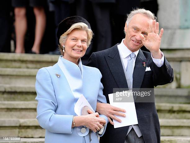 Archduke Christian of Austria and Archduchess MarieAstrid of Austria wave as they leave the Saint Epvre Basilica after the wedding of their son...