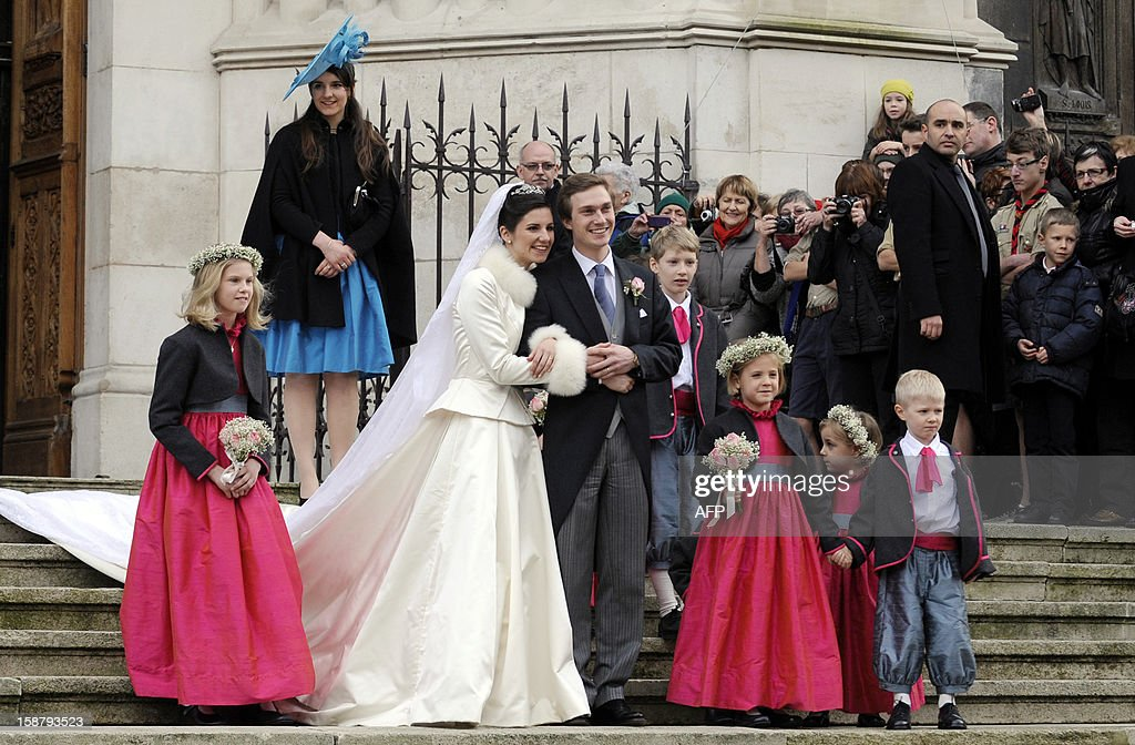 Archduke of Austria Christoph of Habsbourg-Lorraine (C) poses flanked by Archduchess Adelaide Drape-Frisch, next to her sister Eleonor Drape-Frisch (2ndL), as they leave the Saint-Epvre Cathedral after being married, on December 29, 2012, in Nancy.