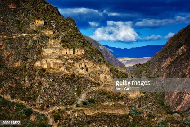 Archeaological site of Pinkuylluna ruins on mountain, seen across valley from Ollantaytambo in Sacred Valley, Peru