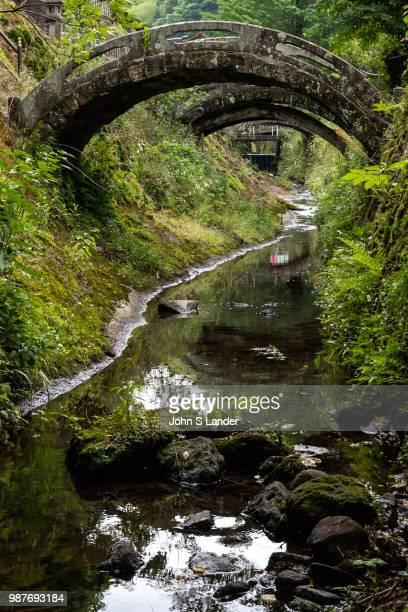 GINZAN OMORI SHIMANE JAPAN Arched Bridges at GohyakuRakanRakanji a Shingon Buddhism temple built in 1776 to hold memorial services for local silver...