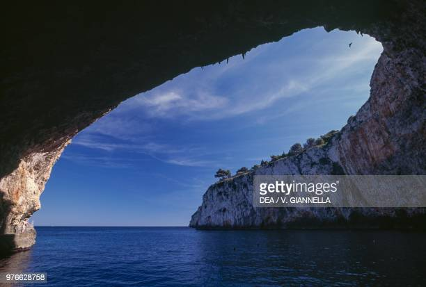 Arched cave along the limestone cliffs of Salento Apulia Italy