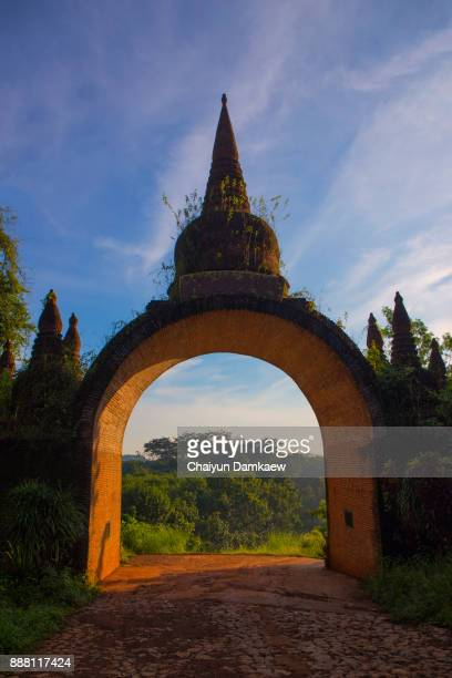 arched door of the temple - khmer art stock photos and pictures