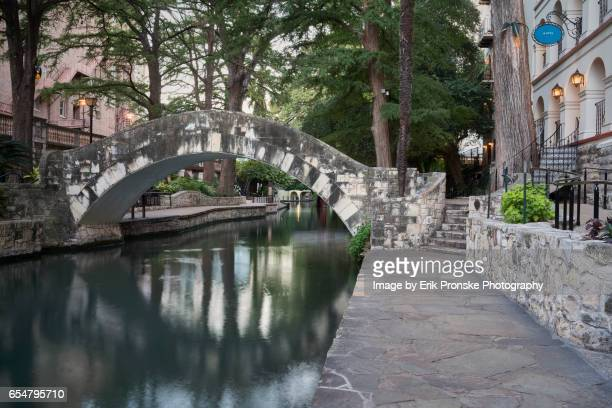 arched foot bridge - san antonio stock photos and pictures