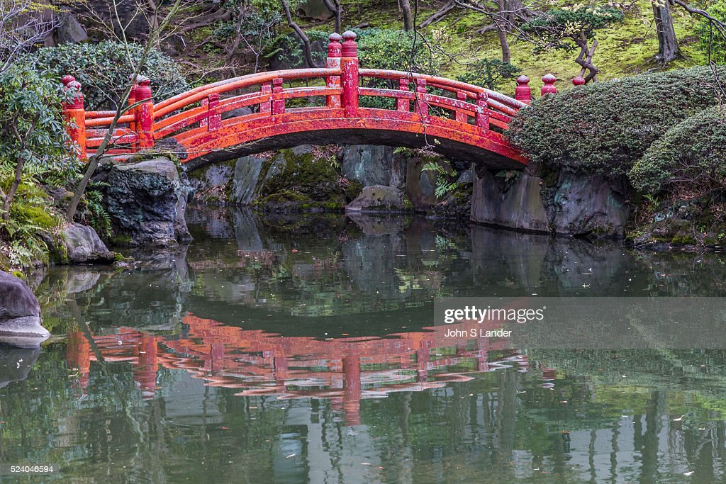 arched red japanese bridge at kyu yasuda teien garden the grounds were once the grounds - Red Japanese Garden Bridge