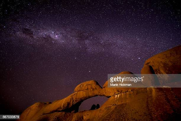 Arched rock with Milky Way overhead at Spitzkoppe.