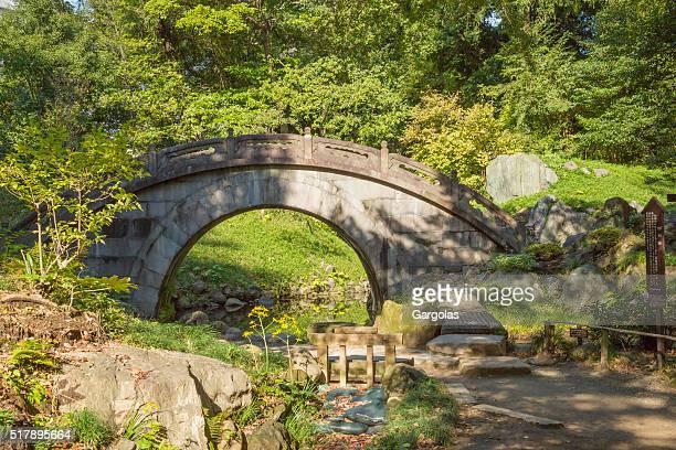 arched stone bridge in japanese garden koishikawa korakuen tokyo
