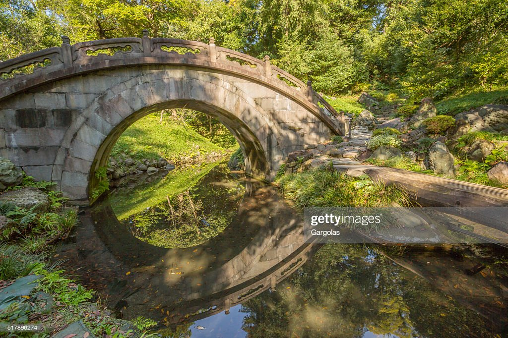 arched stone bridge in japanese garden koishikawa korakuen tokyo stock photo - Japanese Garden Stone Bridge