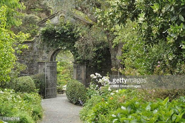 Arched stone gateway through walled Garden.