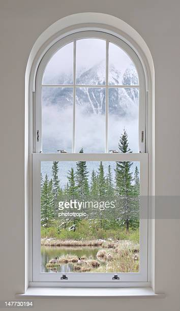 arched window with mountain views