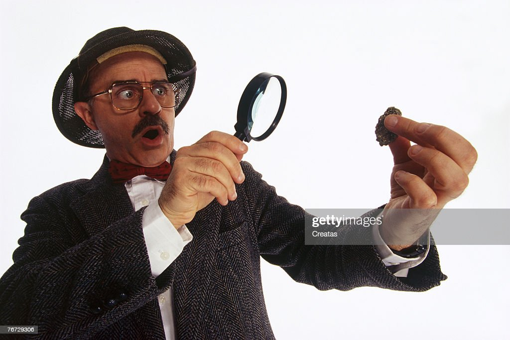 Archeologist examining artifact : Stock Photo
