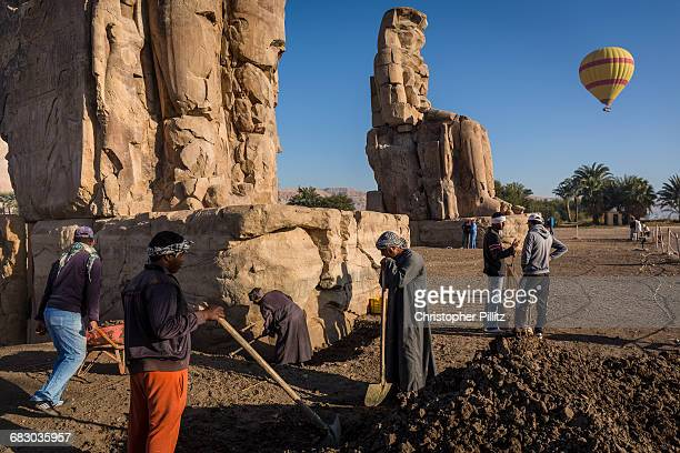 Archeologists at work at the Colossi of Memnon