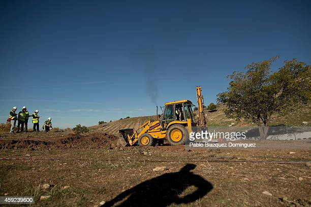 Archeologists search for a mass grave of victims of the civil war on November 19 2014 in Alfacar near Granada Spain Spanish poet and playwright...