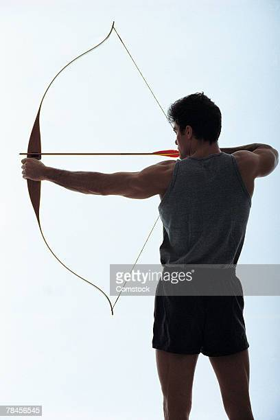 Archer aiming arrow
