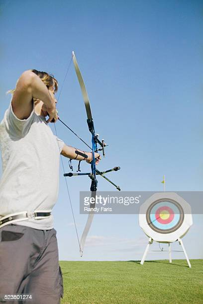 Archer Aiming at Target