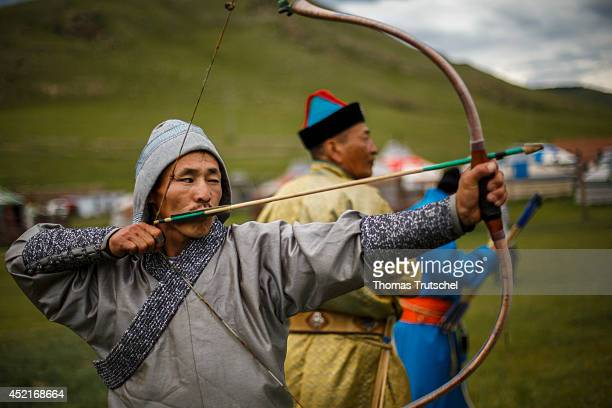 Archer aiming during a mini Nadaam festival at the Chinggis Khaan Khuree Ger camp close to Ulan Bator on July 06 in Ulan Bator Mongolia Nadaam is a...